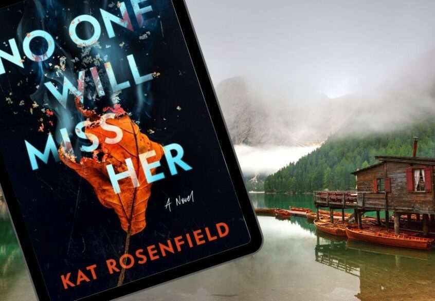 The book No One Will Miss Her in front of a lake